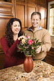 man and woman arranging flowers. poster