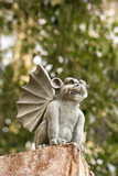low angle of stone gargoyle statue outdoors. poster
