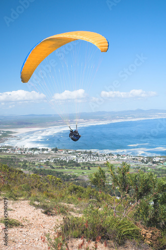 paraglider ridge soaring next to the mountain