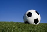football against blue sky poster