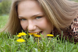 pretty girl bites dandelionm poster