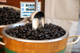 black olives in a market barrel