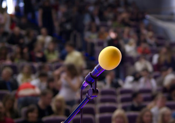 microphone on the stage and audience