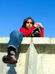 kid on a wall