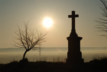 cross silhouette and morning sky