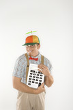 young man dressed like nerd holding large calculator. poster