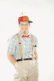young man dressed like nerd with hands in pockets. poster
