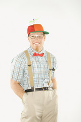 young man dressed like nerd with hands in pockets.