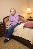 elderly caucasian woman in bedroom. poster