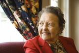 elderly caucasian  woman by window. poster