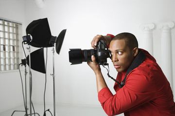 young male photographing in studio.