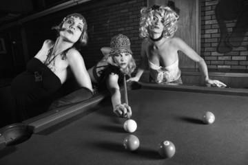 three retro females shooting pool.