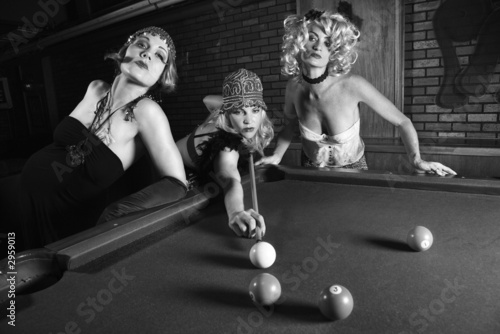 three retro females shooting pool.