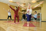 Fototapety adult females in yoga class.