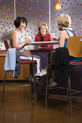adult females sitting at table in health club.