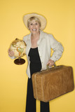 woman holding suitcase and globe. poster
