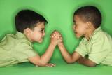 Boys arm wrestling. poster