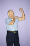 Man flexing muscles. poster