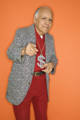 Man wearing money sign necklace and pointing.