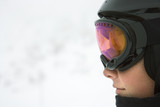 Boy skier wearing goggles and helmet. poster