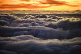 Sunrise over clouds in Haleakala, Maui, Hawaii. poster