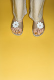Woman feet in flower sandals. poster