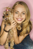 Woman with Yorkshire Terrier dog. poster