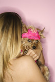 Woman holding Yorkshire Terrier dog. poster