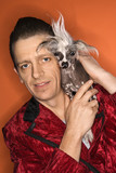 Man holding Chinese Crested dog. poster