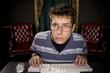 teenage boy studying on comptuer