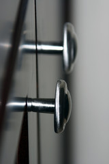 silver knobs on black background