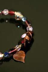 pink beaded braclet with copper heart