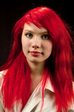 portrait of pretty redhead on black background poster