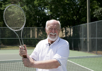senior man plays tennis