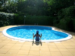 small girl in a pool