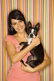Caucasian woman holding Boston Terrier dog. poster