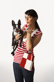 Young Caucasian woman holding Boston Terrier. poster
