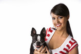 Young Caucasian woman holding Boston Terrier dog. poster