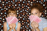 Girls holding cards.
