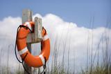 Life preserver on Bald Head Island, North Carolina. poster