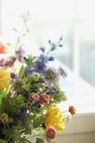 Flower arrangement in front of window. poster