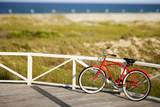 Bicycle leaning against rail on Bald Head Island, North Carolina poster
