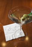 Martini with napkin reading