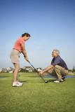 Man teaching woman proper golf techniques. poster