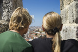 Caucasian woman and boy looking at view in Lisbon, Portugal. poster