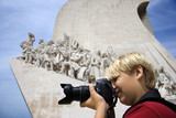 Caucasian boy with camera at the Monument to the Discoveries in poster