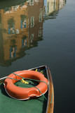 Bow of boat with life preserver. poster