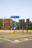 Road signs pointing different directions, Tuscany. poster