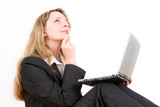 a business woman with a laptop on her knees poster