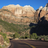 Road winding through cliffs in Zion National Park, Utah. poster